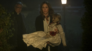 Vera Farmiga (centre) with the possessed doll in Annabelle Comes Home.