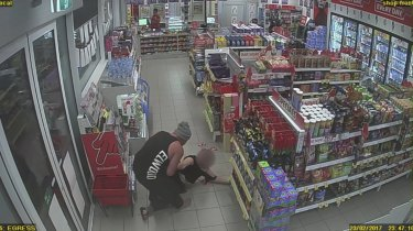 An image from CCTV footage of Josevski dragging his girlfriend out of the service station.