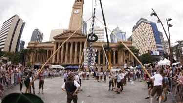 The Oktoberpole is raised during a two-hour process in the heart of Brisbane.