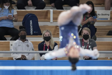 Simone Biles watches Lee from the stands.