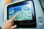 In Flight - May 20th, 2017: Passenger in the airplane watching the flight path on the map during flight to Belgian capital Brussels. iStock image for Traveller. Re-use permitted. Inflight entertainment screens IFE