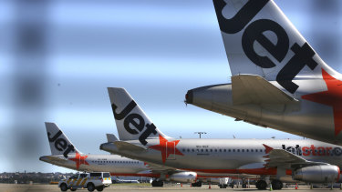 Aircraft sit idle at Sydney Airport, grounded by the coronavirus pandemic.