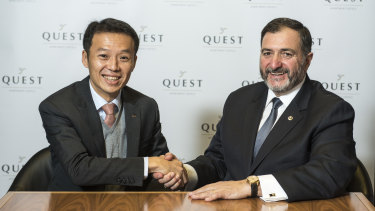 Quest's Paul Constantinou shaking hands with Ascott's Lee Chee Koon after the sale of Quest.