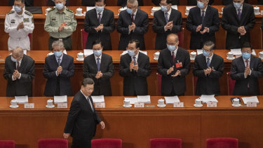 Chinese president Xi Jinping is applauded by delegates at last year's National People's Congress.