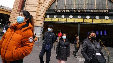 People leave Flinders Street Station on Sunday.