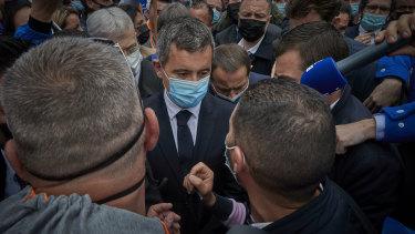 French Interior Minister Gérard Darmanin on the scene.