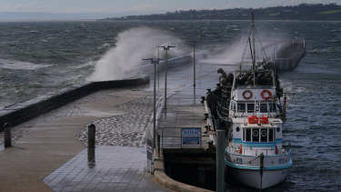 A large wave crashes over the harbour pier in Mornington on Thursday.