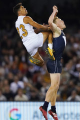 Charlie Cameron of the All-Stars flies high  for a mark over James Sicily.