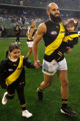 On the field with daughters Sarah and Maryam last year at his 200th game.