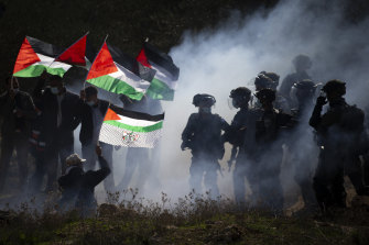 Israeli border police officers clash with Palestinians during a protest against the expansion of Israeli settlements near the West Bank town of Salfit in December.