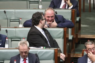 Barnaby Joyce chats to Nationals colleague George Christensen during question time earlier this year.