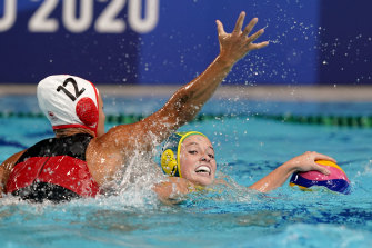Australia's Abby Andrews, right, is defended by Canada's Shae la Roche.