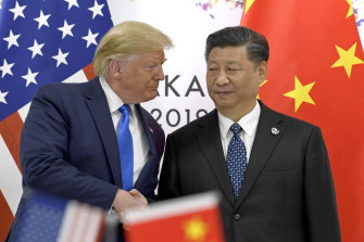 Donald Trump, pictured here with Xi Jinping in 2019, is obsessed by China, Bolton says.