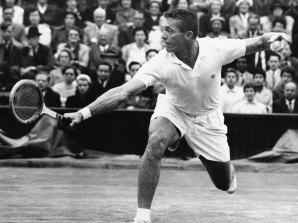 Tony Trabert makes a return to Kurt Nielson on centre court at Wimbledon, July 1, 1955.