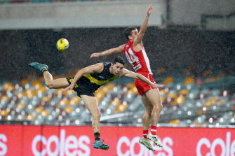 Richmond's Jason Castagna battles Sydney defender Jake Lloyd in a game that saw just seven majors scored.