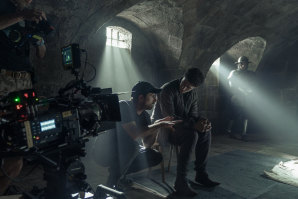 Director David Michod on the set of The King, with Timothy Chalamet as Hal, aka King Henry V.