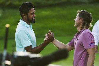 Cameron Smith (right) congratulates Tony Finau after the American's drought-breaking win on the PGA Tour.
