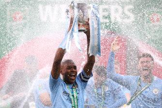 Fernandinho holds the Carabao Cup aloft for Manchester City after beating Tottenham Hotspur at Wembley.