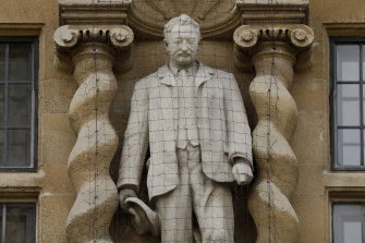 A statue of Cecil Rhodes, the controversial Victorian imperialist who supported apartheid-style measures in southern Africa stands mounted on the facade of Oriel College in Oxford, England.
