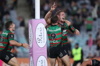 Rabbitohs front-rower Tom Burgess celebrates scoring the winning try against the Wests Tigers.