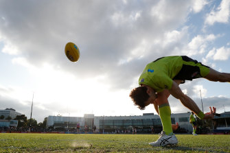 AFL umpires accept pay cut to help keep industry going.