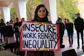 A protester in support of better working conditions for Melbourne University's casual staff in May.