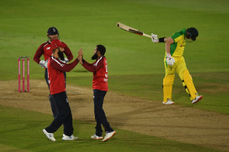 Adil Rashid (right) celebrates the wicket of Steve Smith, one of three scalps taken by the English spinner.