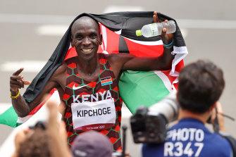 Kenyan Eliud Kipchoge celebrates winning back-to-back Olympic gold medals in the men's marathon.