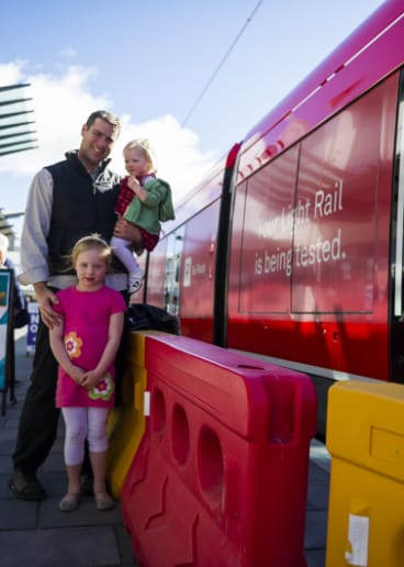 Steven Mirtschin with his daughters Amelia, 5, and Georgia, 1. Steven's business has  suffered because of light rail construction.