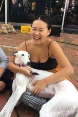 Ingrid Chen cuddles Porscha the greyhound.