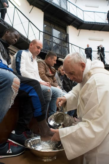 Pope Francis washes the feet of inmates during his visit to a detention centre in Rome in a pre-Easter ritual.
