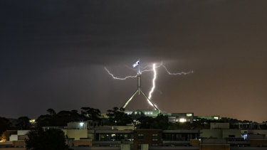 Lightning strikes over Canberra on Tuesday night as a storm front rolled through.