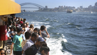 The Narrabeen is packed with day trippers as it sails from Circular Quay to Manly on Sunday.