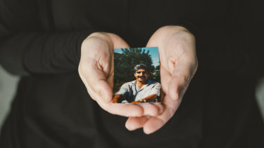 Mariya Tueter holds a photo of her late husband, one of Niels Hoegel's many victims.