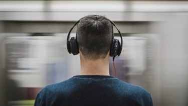 Over-ear headphones that make a good seal and have noise cancelling are the best picks.