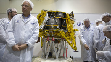Israeli technicians stand next to the SpaceIL lunar module during a press tour of their facility near Tel Aviv last December.