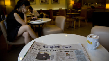 """A copy of the Bangkok Post carries a story about the """"separatism"""" movement and prohibited T-shirts."""