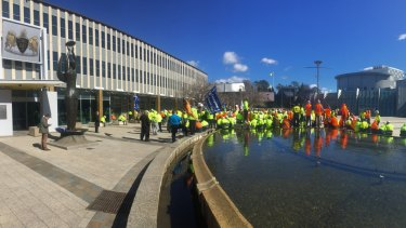 Members of ACT unions rally outside the ACT Legislative Assembly.