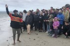 Gunditjmara man Chris Saunders invites those attending the smoking ceremony at the Convincing Ground, near Portland, to remember the spirits of those massacred on the beach.
