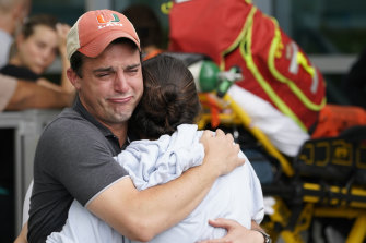 A couple embrace as they wait for news of survivors from the collapse.
