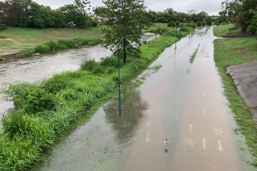 Local flooding at Kedron Brook in the Brisbane suburb of Lutwyche on Saturday.