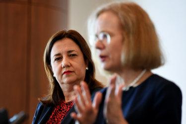 Queensland Premier Annastacia Palaszczuk (left) watches Queensland Chief Health Officer Dr Jeannette Young