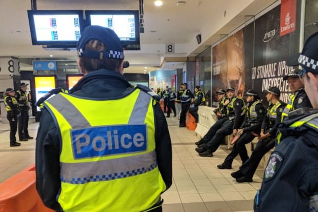Police gathered at Flinders Street Station.