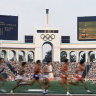 Competitors run in the men's 5,000 meters at the Olympic Games in Los Angeles.