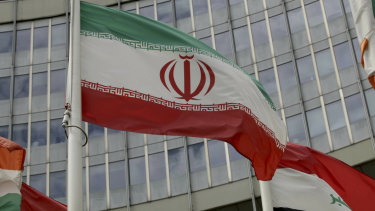 The Iranian flag waves outside of the UN building that hosts the International Atomic Energy Agency, IAEA, office inside in Vienna.