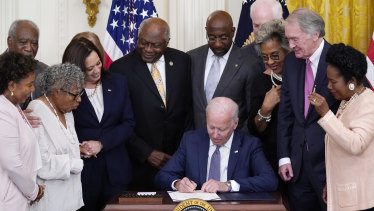 President Joe Biden signs the bill in the East Room of the White House.