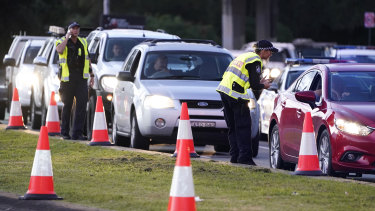 Motorists are stopped at a checkpoint at Coolangatta on the Queensland/NSW border.