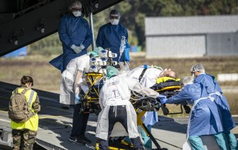 A COVID-19 patient at Avignon  is evacuated on a French Air Force plane to Brest. As hospitals near capacity in France, patients requiring urgent treatment are being transferred across the country.