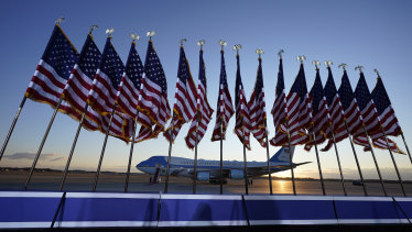Air Force One is prepared for outgoing US president Donald Trump as flags fly on a stage at Andrews Air Force Base.