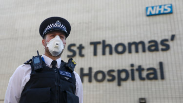 A police officer outside St Thomas' Hospital, where Boris Johnson was being treated.